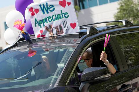 Vehicles drive through to thank Southwest Medical physicians and nurses for their frontline wor ...