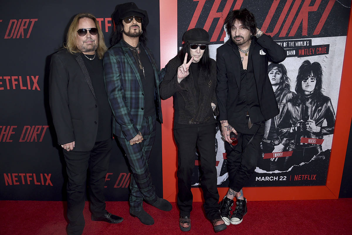 Vince Neil, from left, Nikki Sixx, Mick Mars and Tommy Lee, of Motley Crue, arrive at the world ...