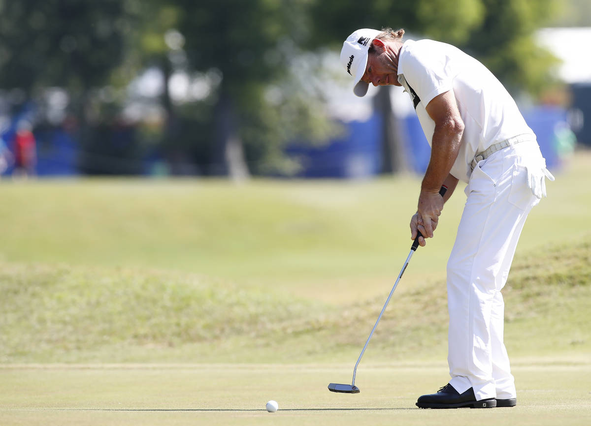 Alex Cejka, of Germany, putts on the first green during the final round of the PGA Zurich Class ...