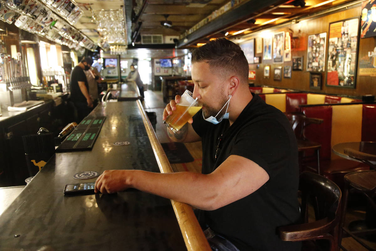Cheers to You patron Mike Turner drinks a beer at the bar Friday, May 1, 2020, in Salt Lake Cit ...
