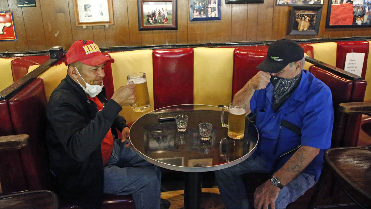 Cheers to You patrons Clifford Pesheep, left, and Mark Patterson drink beer at Cheers to You ba ...