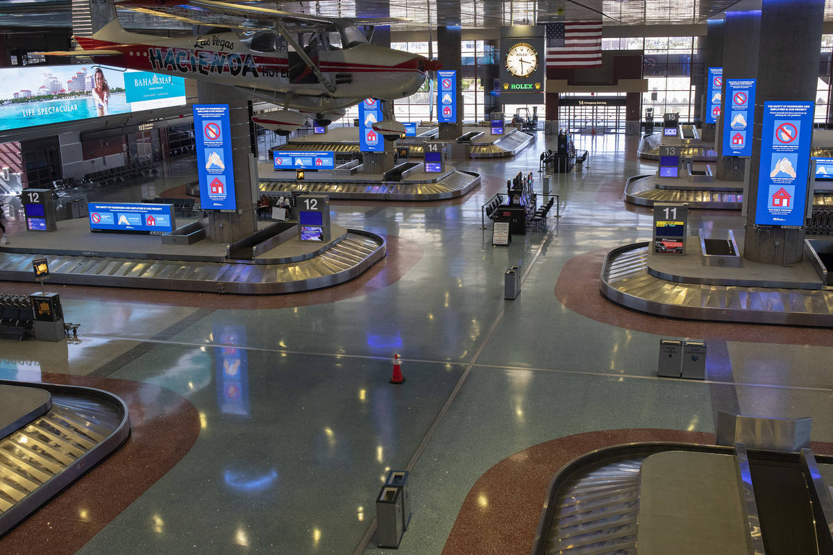 Baggage claim in Terminal 1 is empty at McCarran International Airport on Wednesday, April 1, 2 ...