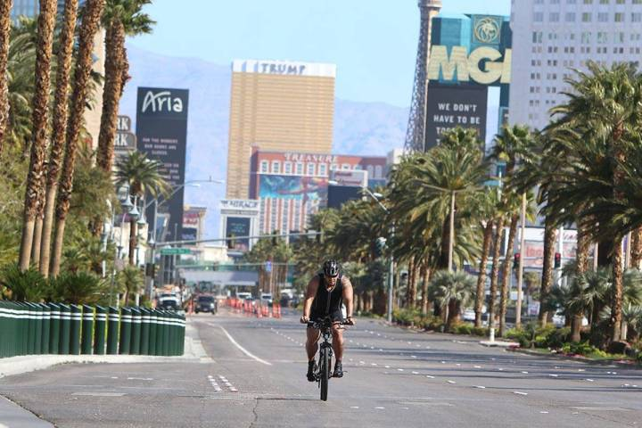 A man rides his bike along Las Vegas Boulevard South during a sunny Tuesday, April 14, 2020, in ...