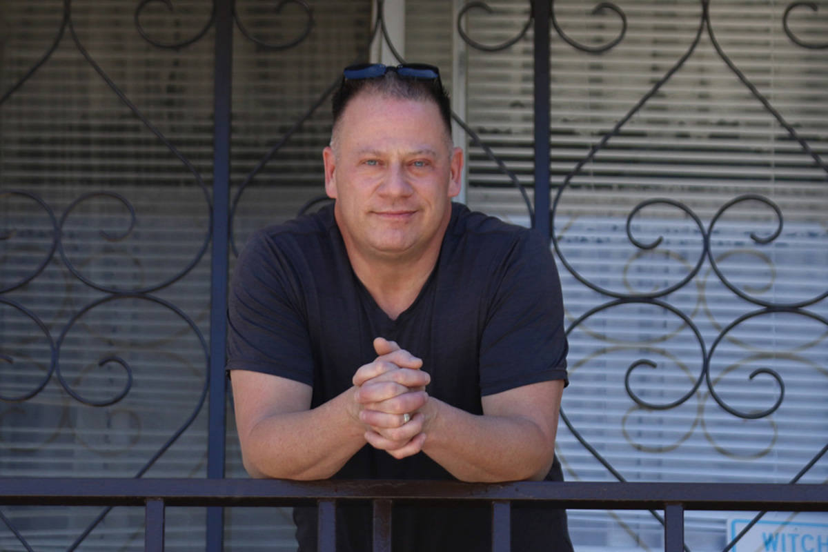 Alan Scialpi, former convention center employee, poses for a photo outside of his Las Vegas apa ...