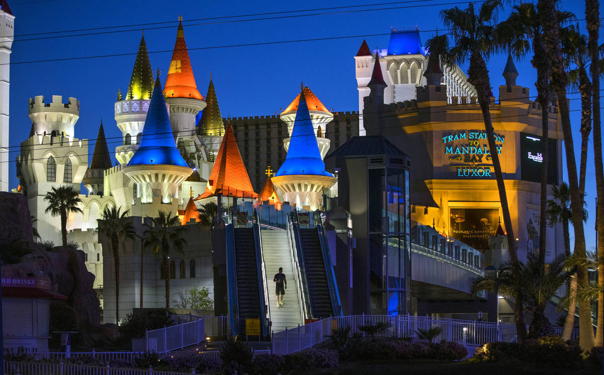 A pedestrian walks down from the bridge across from the Excalibur at Las Vegas Boulevard on the ...