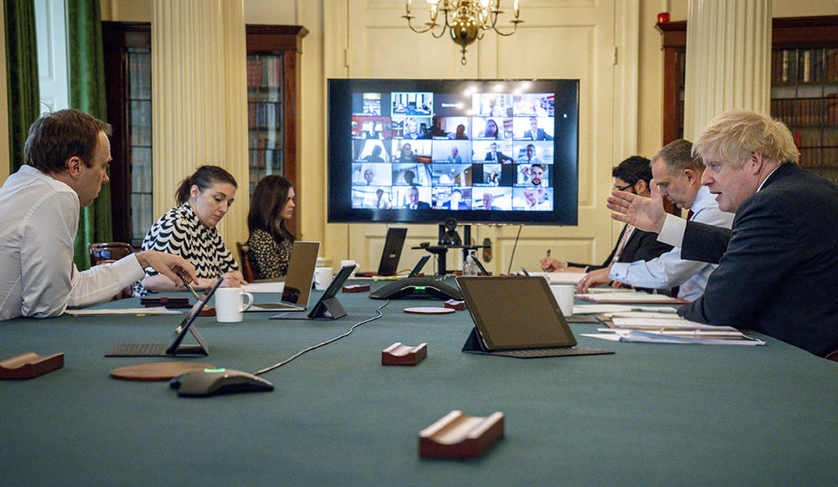 In this photo provided by 10 Downing Street, Britain's Prime Minister Boris Johnson chairs his ...
