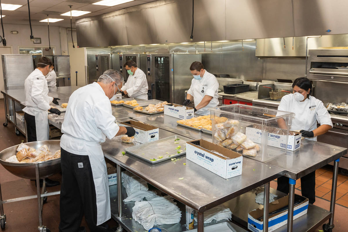 The Venetian's Culinary Team wraps sandwiches for the meal donation to Catholic Charities of So ...