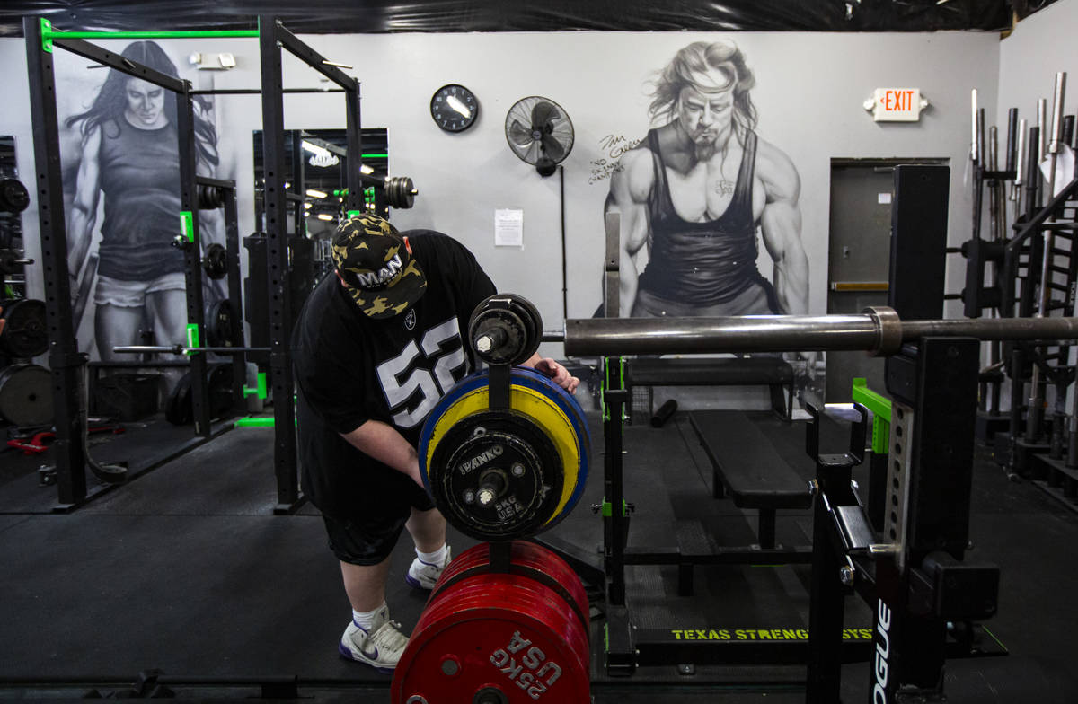 Paul Minor grabs weights at The Lift Factory in Las Vegas on Thursday, Feb. 27, 2020. (Chase St ...