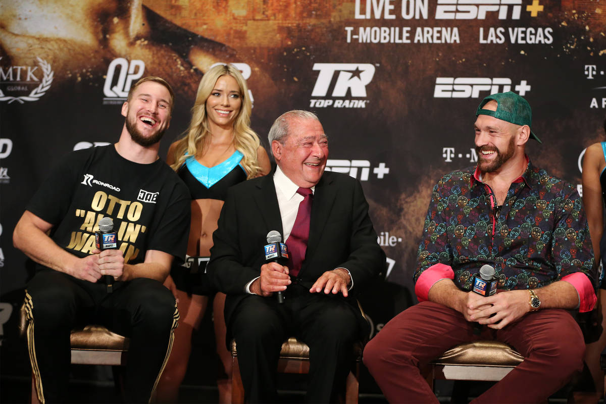 Otto Wallin, from left, boxing promoter Bob Arum and Tyson Fury, share a laugh during a press c ...