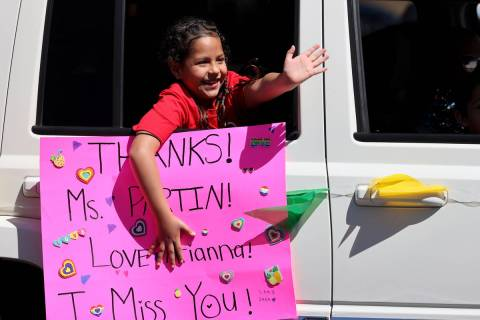 Legacy Traditional School Southwest second grader Arianna Tapia during an appreciation parade a ...