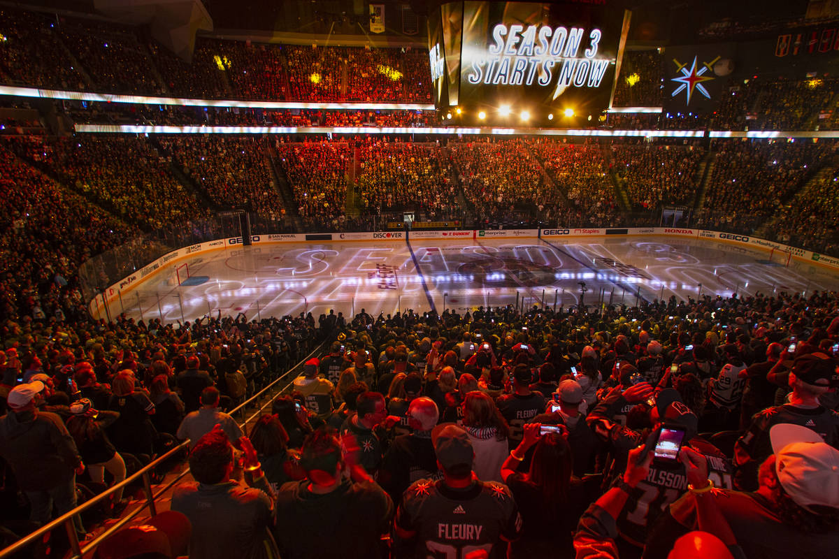 Season 3 starts sign above the crowd and on the ice before the start of the first period of the ...
