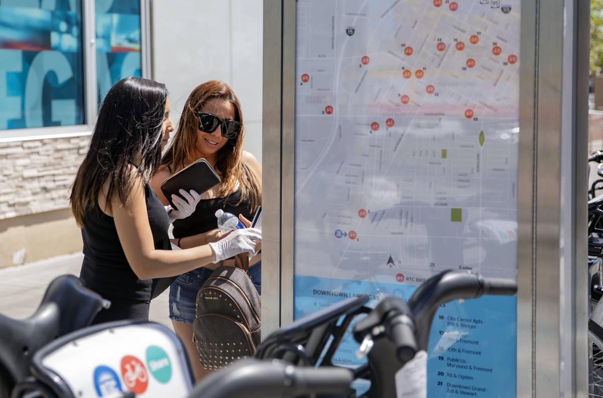 Reina Leyva, left, and Maribel Leyva rent their RTC Bike Shares from the East Sahara Ave., and ...