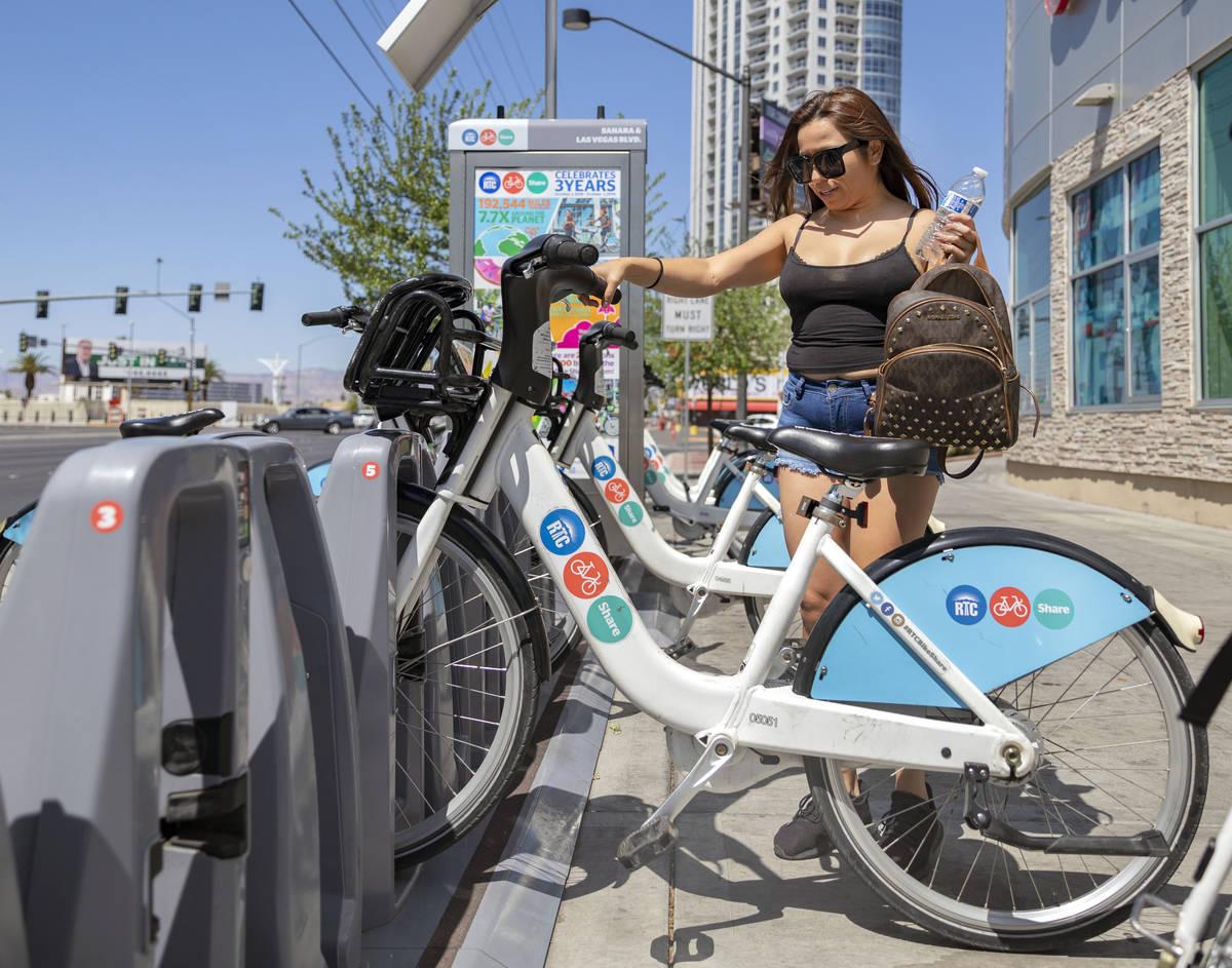 Maribel Leyva rents an RTC Bike Share from the East Sahara Ave., and Las Vegas Blvd., bike shar ...