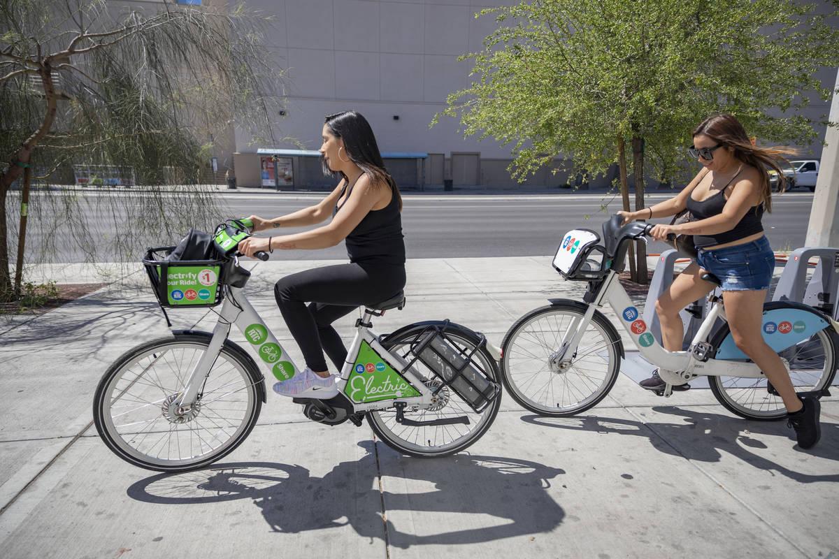 Reina Leyva, left, and Maribel Leyva, use RTC Bike Shares from the East Sahara Ave., and Las Ve ...