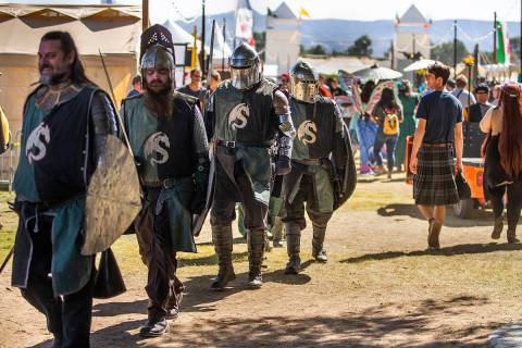Knights make their way with others up the road about the Royal Court area during the Age of Chi ...