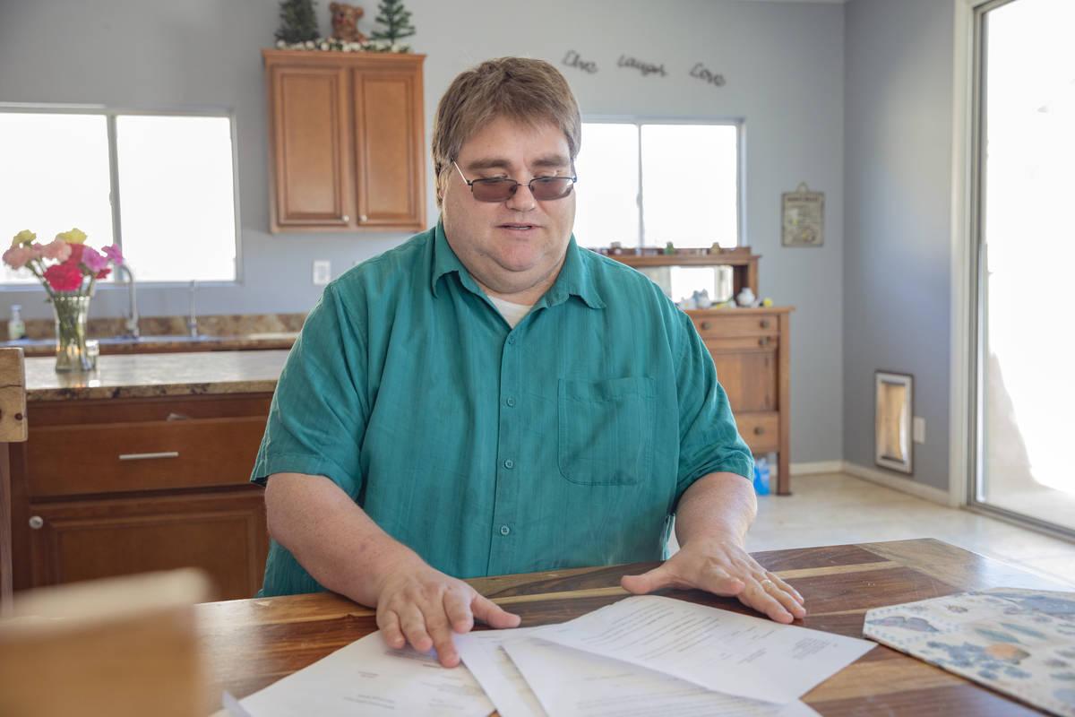 Rodney Fife, 41, displays the complaints sent to Gov. Steve Sisolak, in his parent's home locat ...