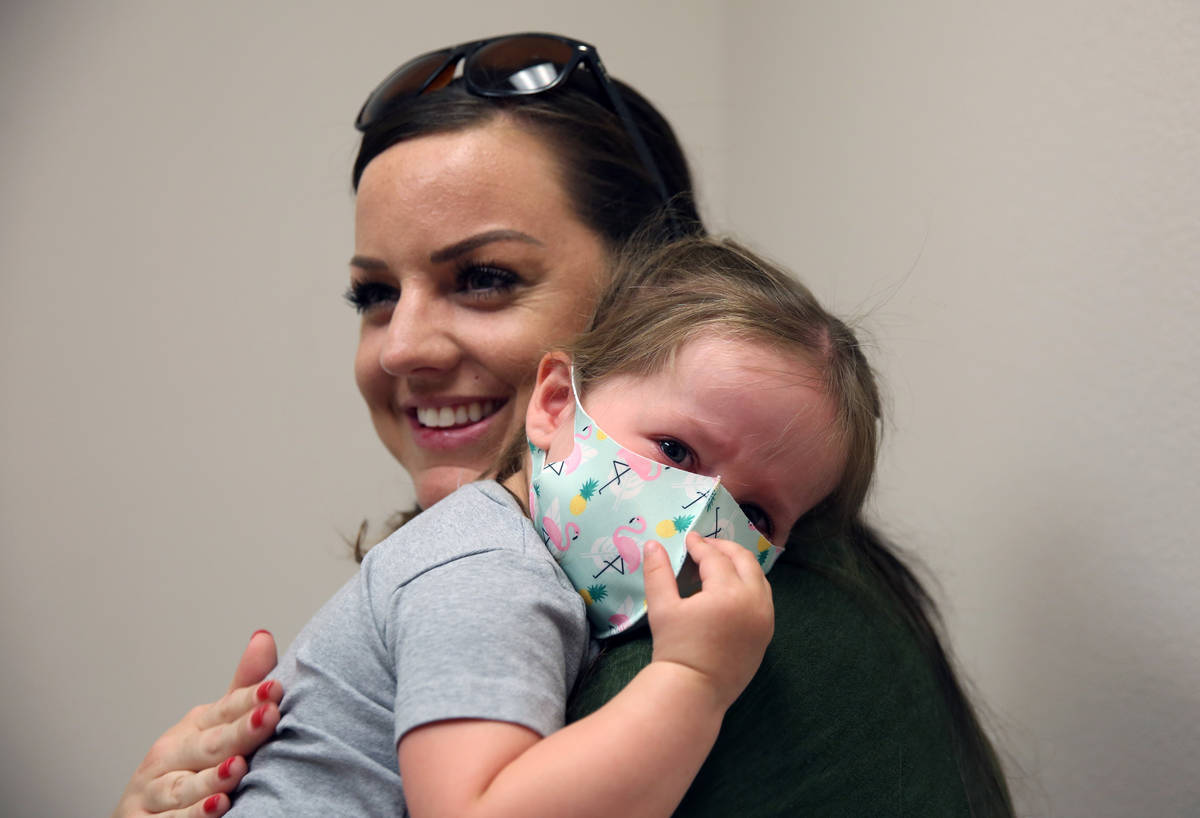 Olivia Hippert, 2, is comforted by her mother Amanda after she got her Hepatitis A vaccine at D ...