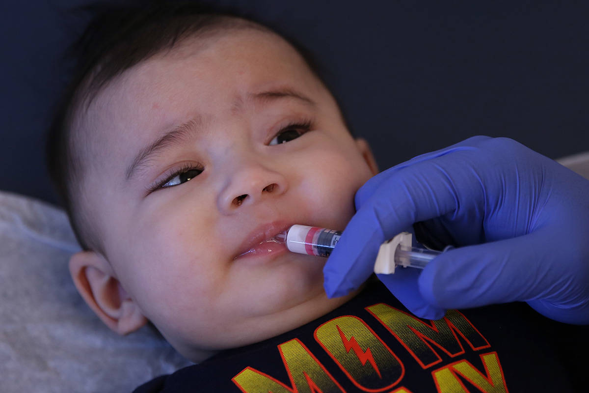 Aries Cano, 4, receives Rotavirus oral vaccine from Stephen Hibler, a medical assistant at Dess ...