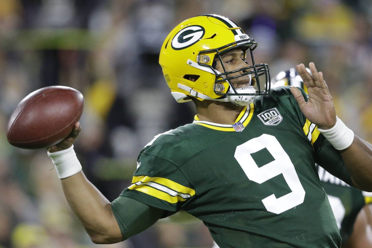 Green Bay Packers' DeShone Kizer throws during the first half of an NFL football game against t ...