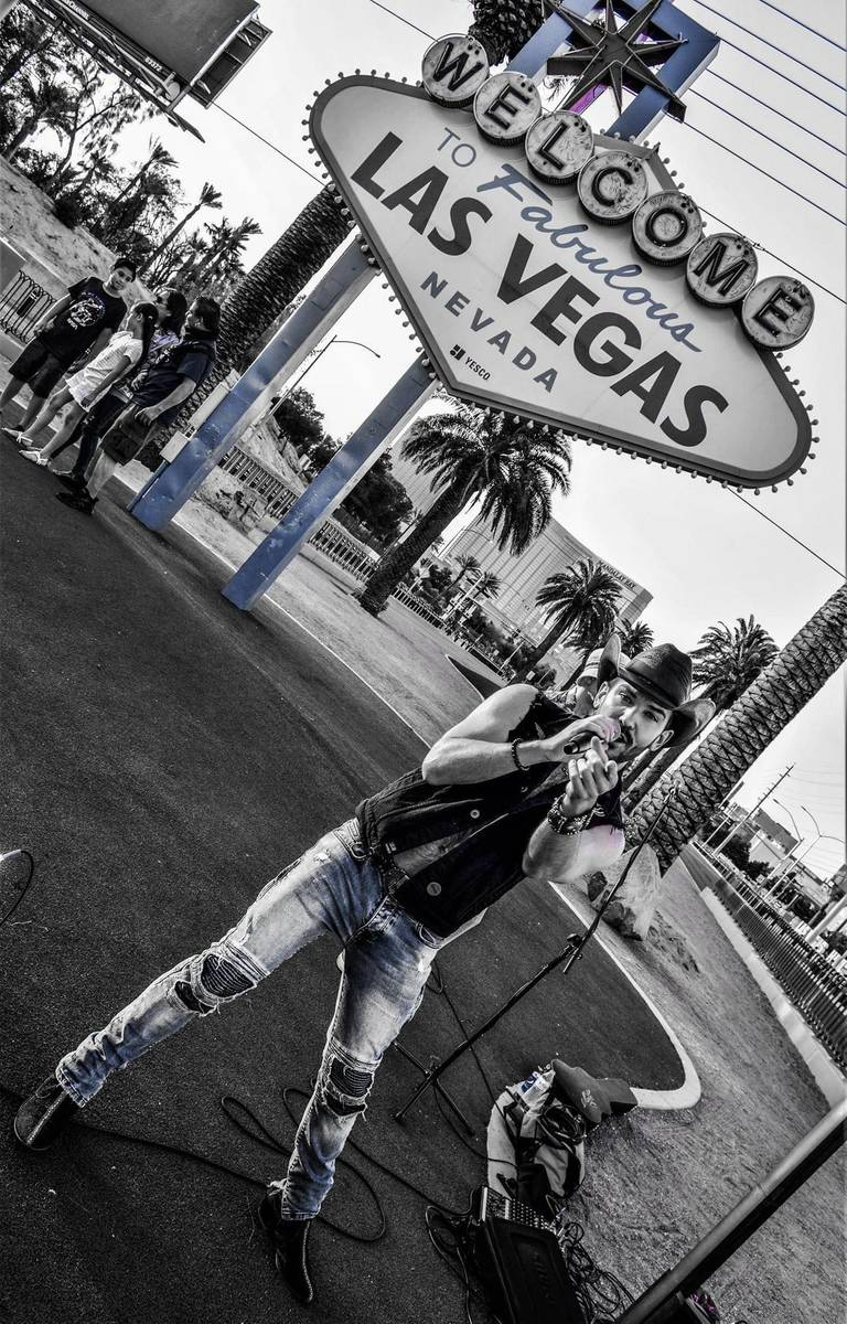 Country artist Chase Brown is shown at the Welcome to Las Vegas Sign while performing a Faceboo ...