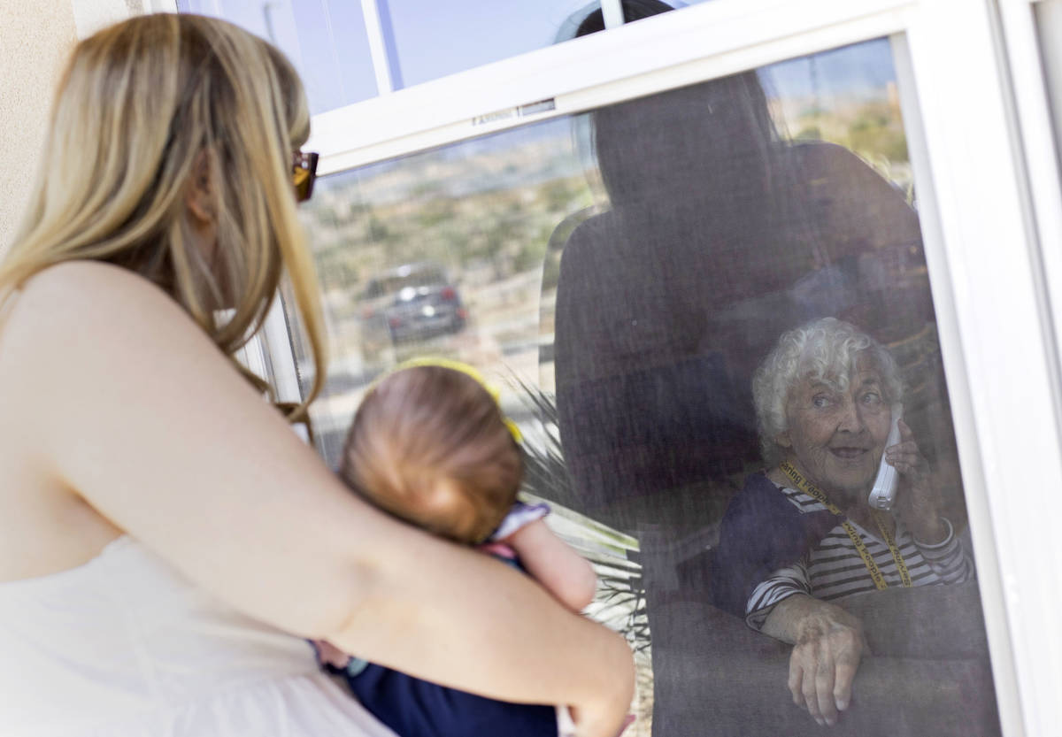 June Watkins, 97, beams at her one-month-old great granddaughter, Eliana, as her granddaughter ...