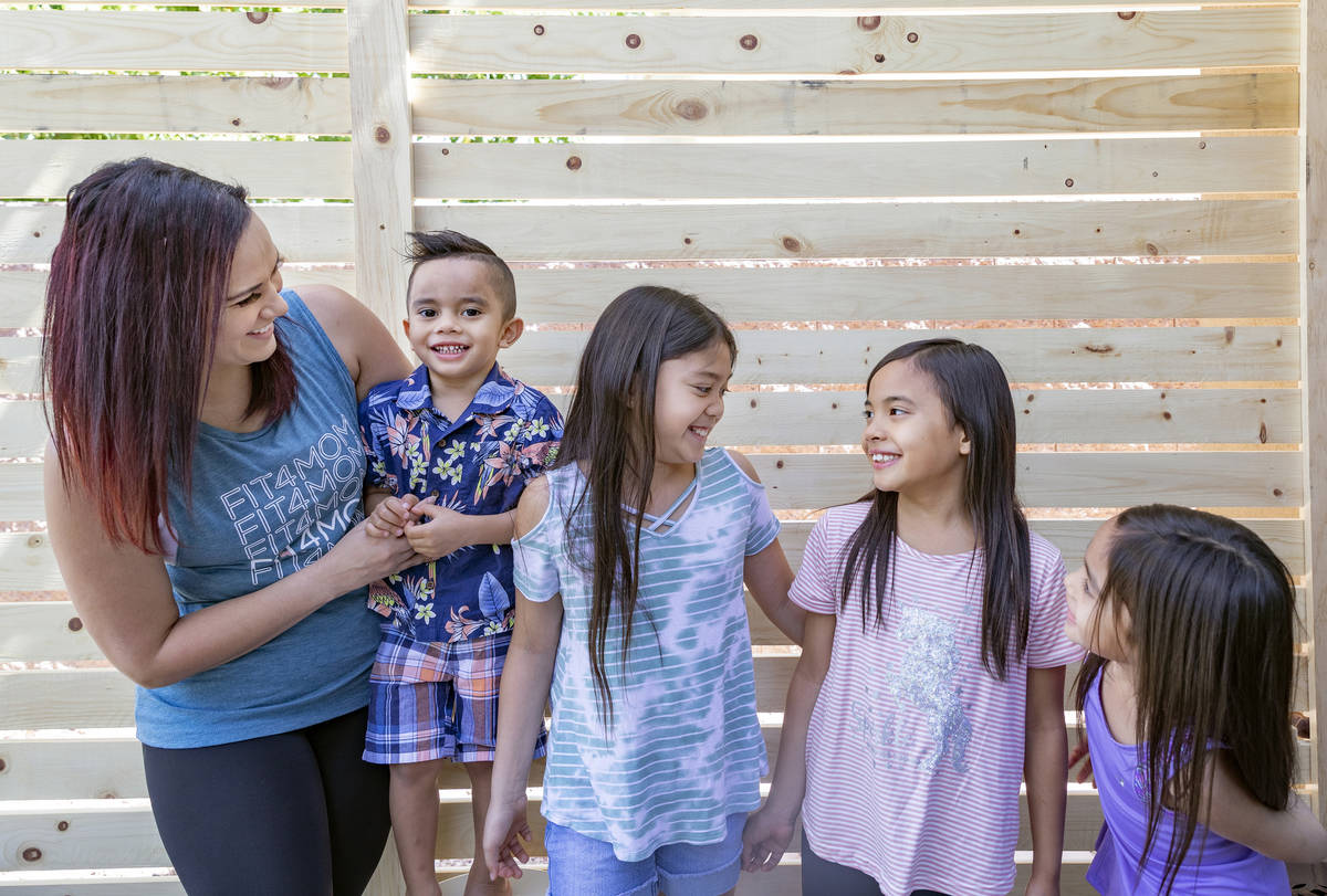 Owner of FIT4MOM Las Vegas Jessica Peralta is photographed with her four children, Giovanni, 3, ...