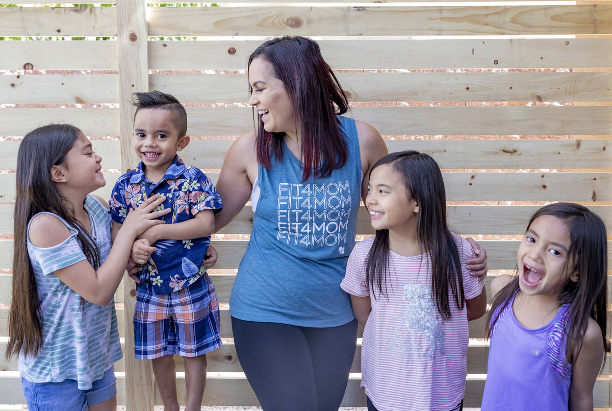 Owner of FIT4MOM Las Vegas Jessica Peralta is photographed with her four children, Grace, 9, fr ...