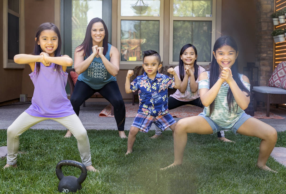 Owner of FIT4MOM Las Vegas Jessica Peralta is photographed with her four children Moriah, 6, fr ...