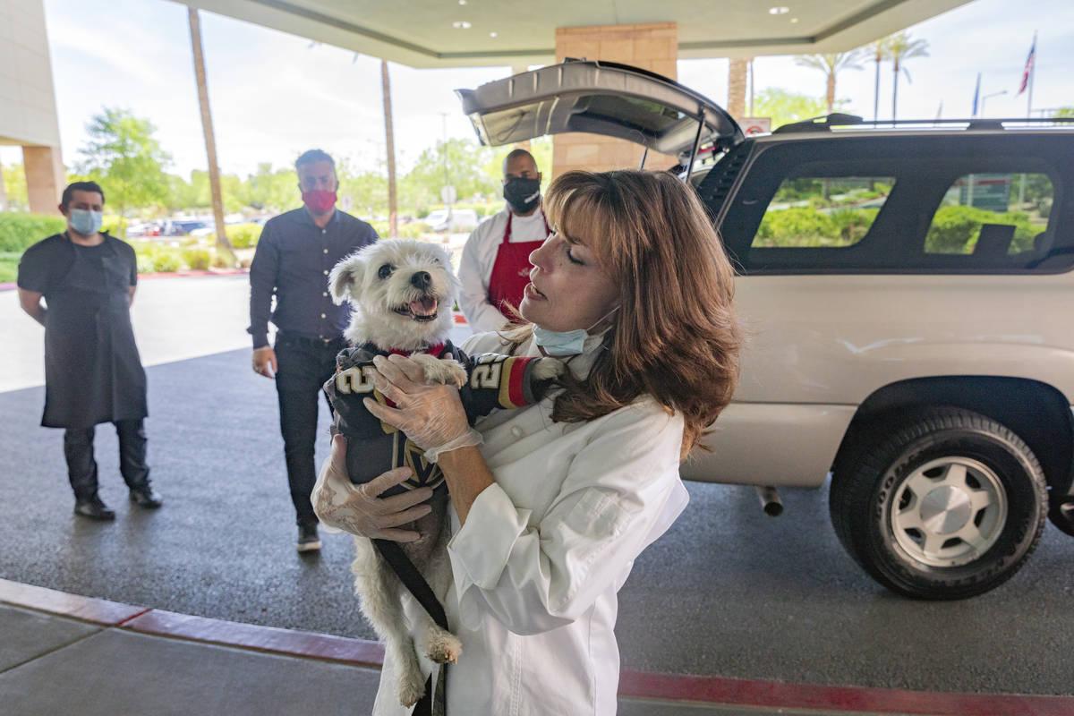 Owner of Louisiana kitchen Lola's, Lola Pokorny,holds Bark-Andre Furry at Summerli ...