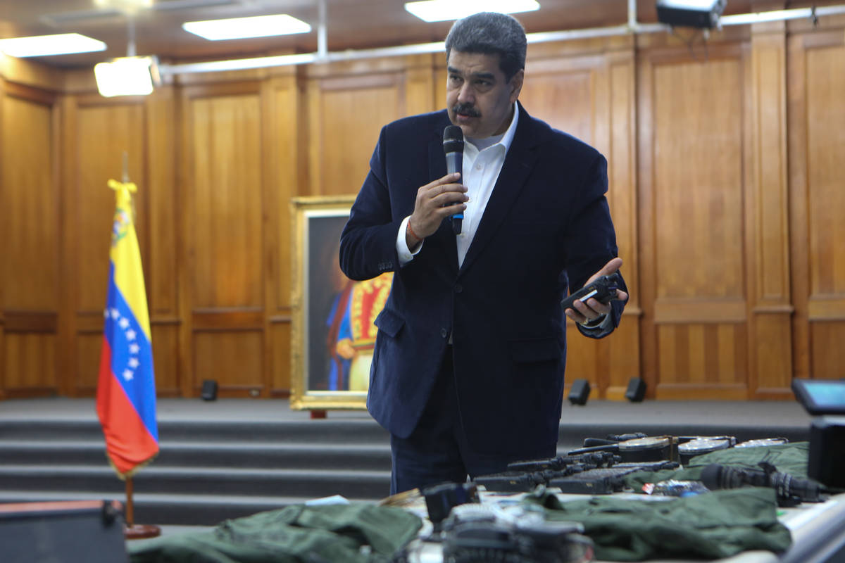 This photo released by the Venezuelan Miraflores presidential press office shows President Nico ...