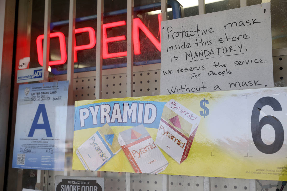 Masks are required at the Shop For Less store on West Main Street in Barstow Calif. Tuesday, Ma ...