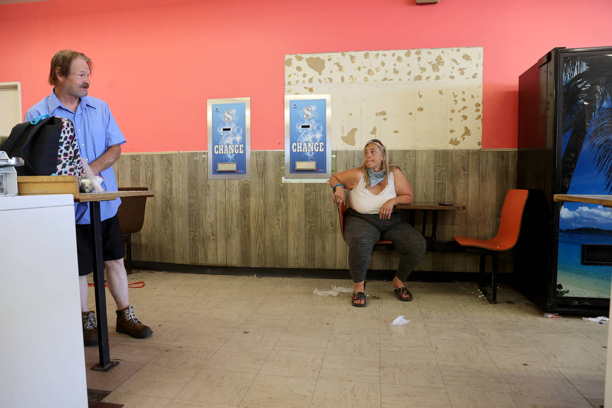Michelle Fuller Hines talks to a Larry Shaw, 60, at Emmy's Laundromat on East Main Street in Ba ...