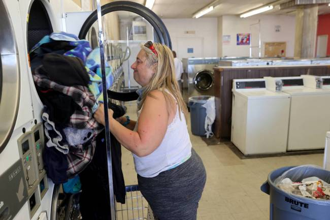 Michelle Fuller Hines at Emmy's Laundromat on East Main Street in Barstow Calif. Tuesday, May 5 ...