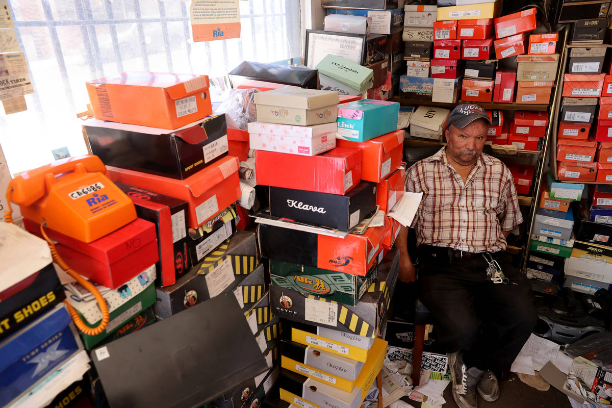 Pedro Valencia waits for customers at his shoe store on 2nd Avenue near East Main Street in Bar ...