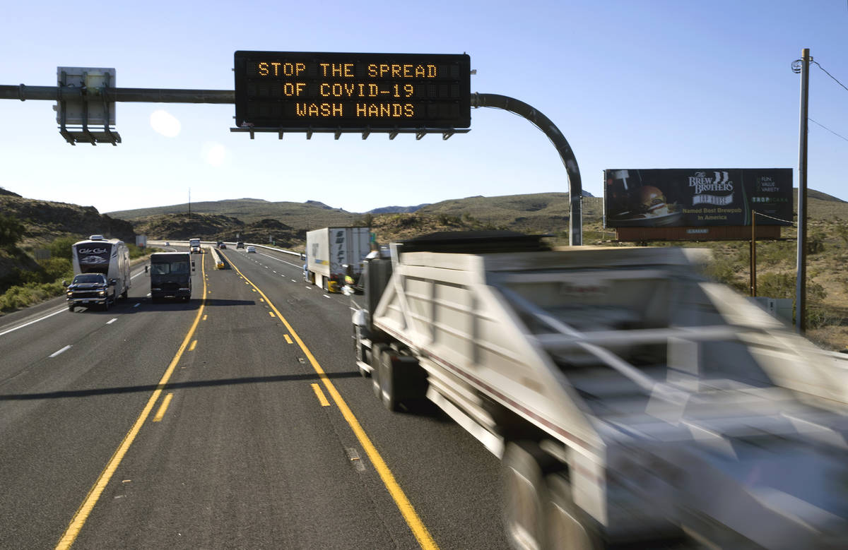 Drivers are encouraged to wash their hands from an electronic reader board along U.S. Highway 9 ...