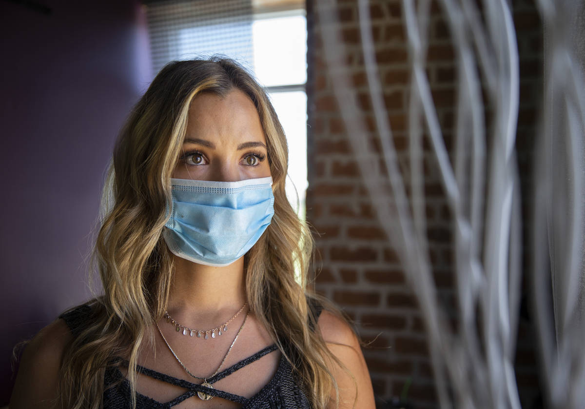 Stylist Vanessa Faylor wears a medical mask at Khroma Salon on Tuesday, May 5, 2020, in St. Geo ...