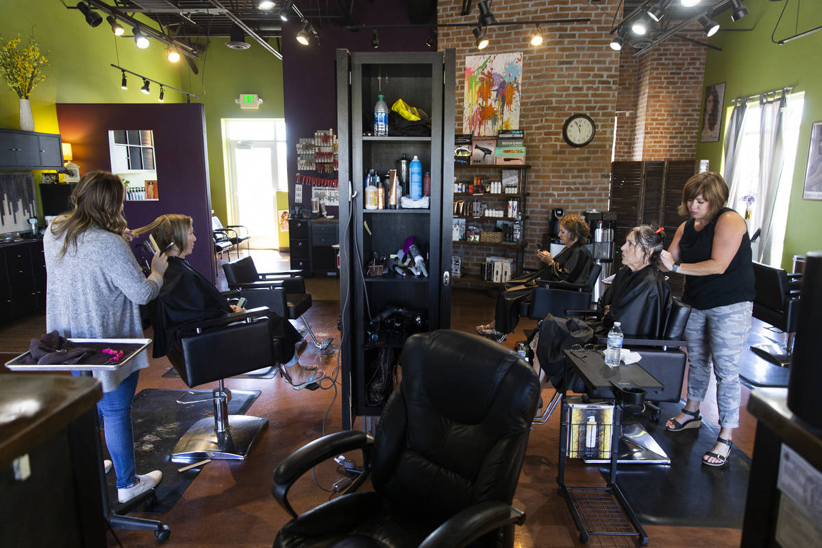 Owner/stylist Brittany Patience, right, cuts Mary Jane Campbell's hair at Salon Khroma on Tuesd ...