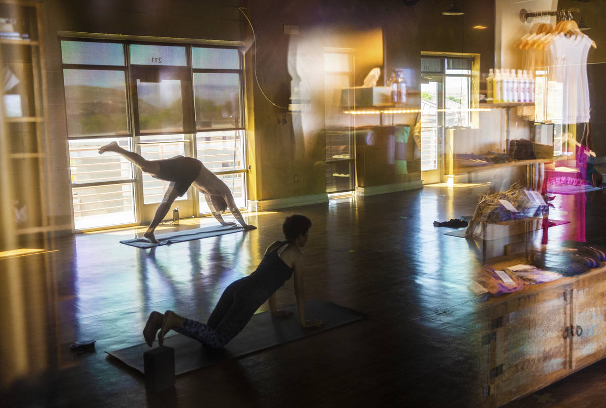 A hot flow class is taught at Be Hot yoga on Tuesday, May 5, 2020, in St. George, Utah. (Benjam ...