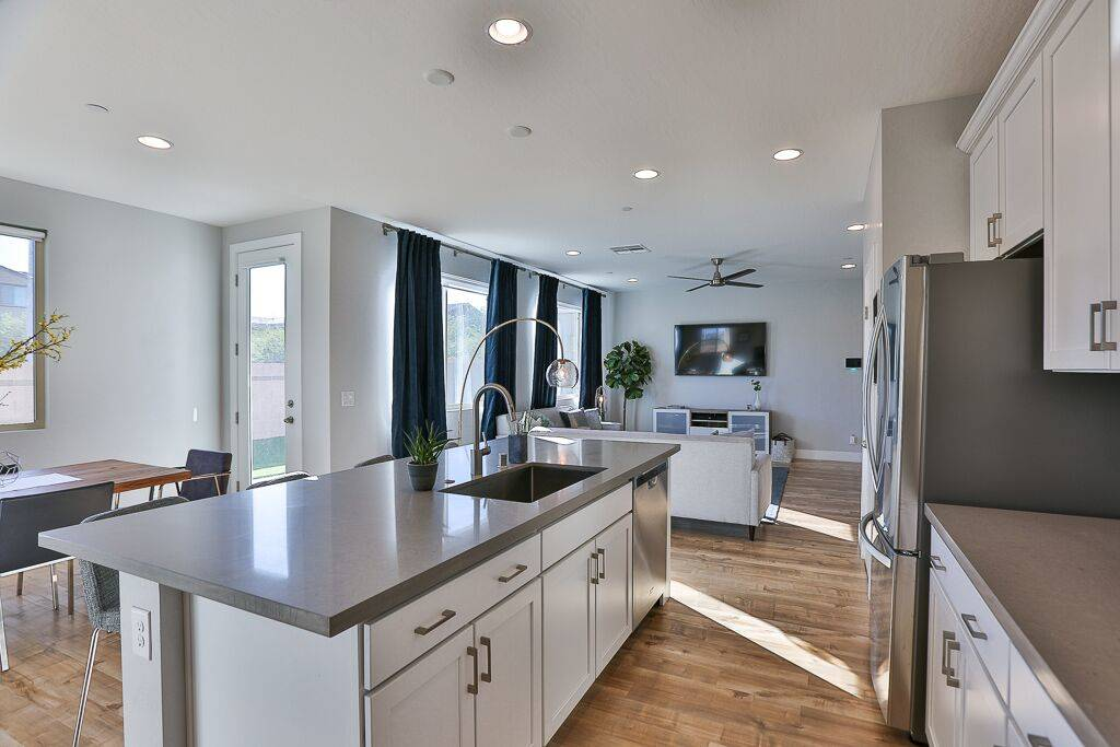 The Inspirada home features a kitchen with 42-inch raised panel cabinets and quartz countertops ...