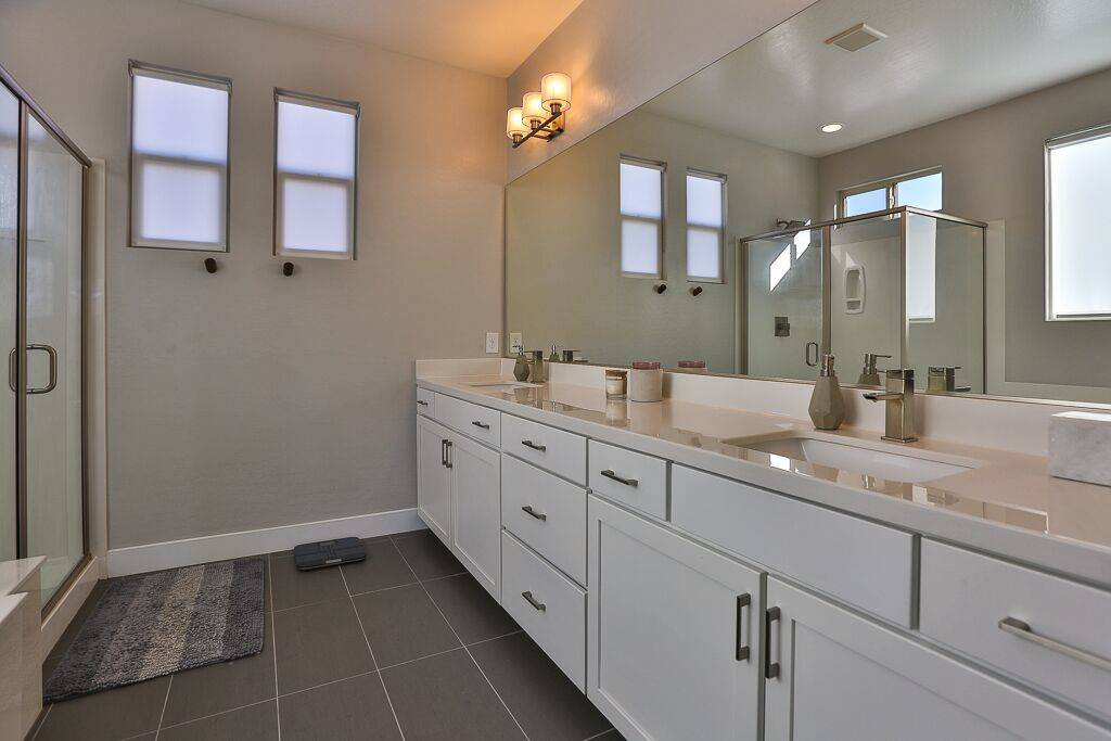 The master bath has lots of cabinet space for storage and a large shower. (Life Realty)