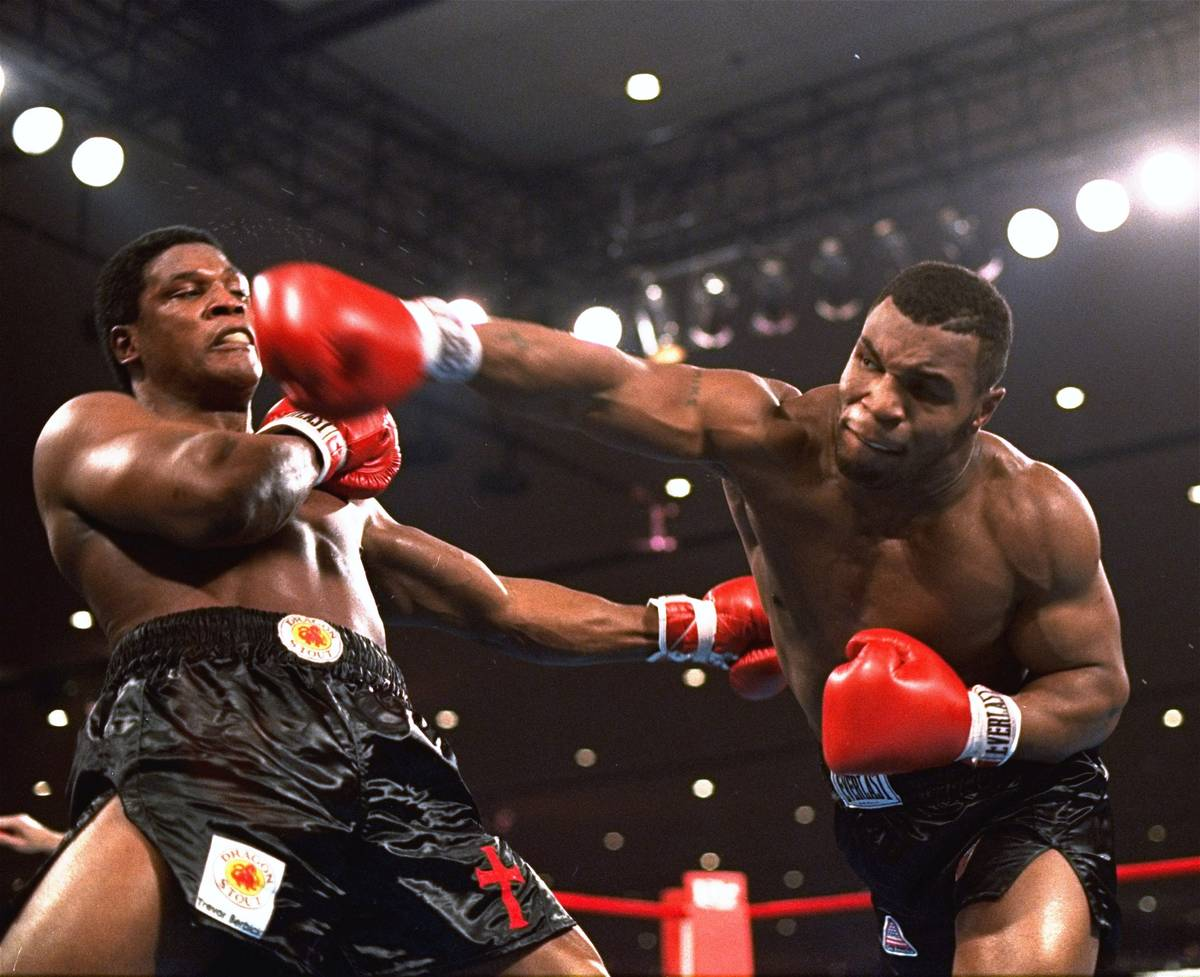 In this Nov. 22, 1986, file photo, Mike Tyson, right, delivers a blow to Trevor Berbick during ...