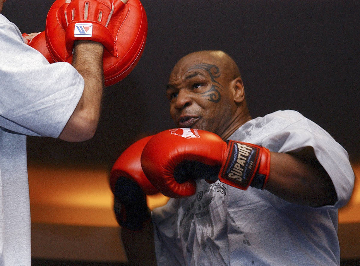 In this Aug. 30, 2006, file photo, former heavyweight boxing champion Mike Tyson spars during a ...