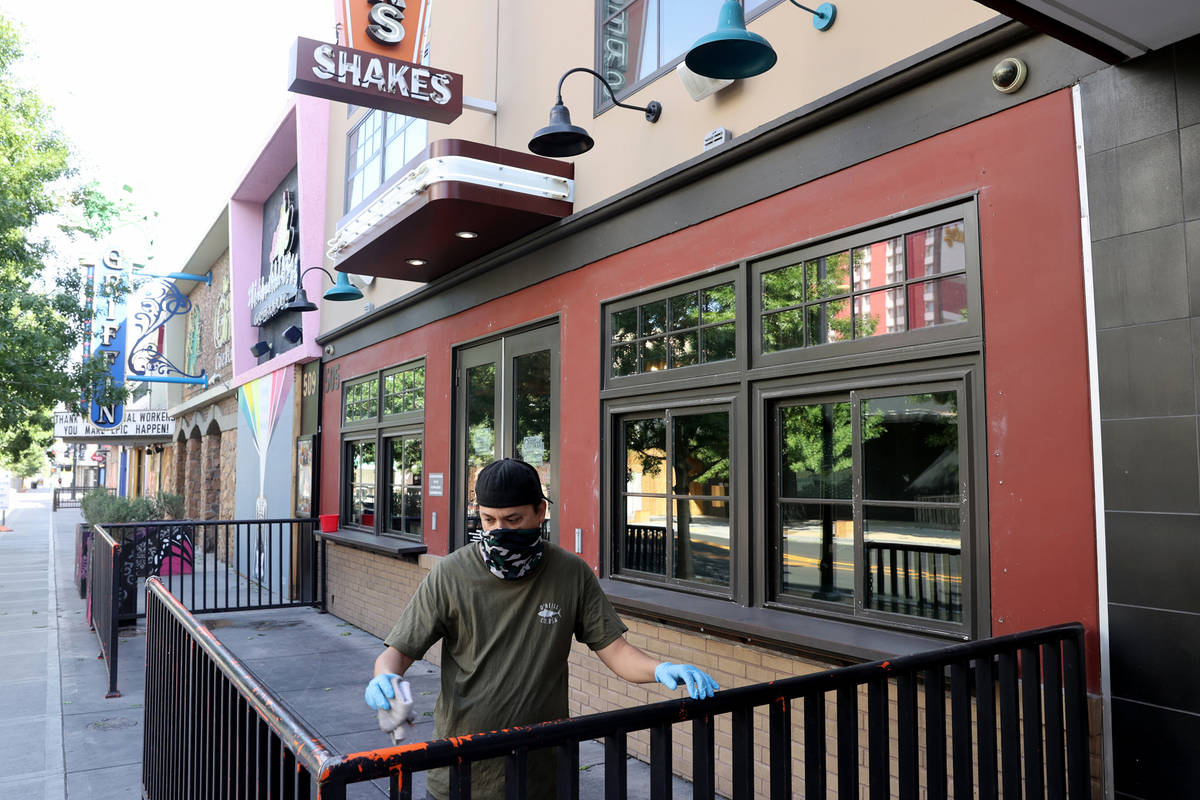 Ken Mattox, assistant manager at Flippin' Good Chicken, Burgers, Beer on East Fremont Street in ...
