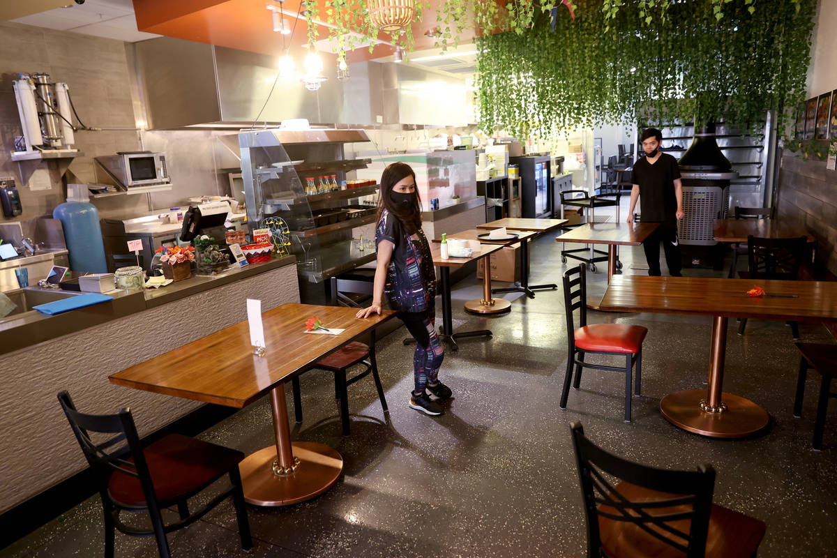 Siam Square server Jenny Prapasanobol and partner Tao Namwichai arrange tables six feet apart T ...