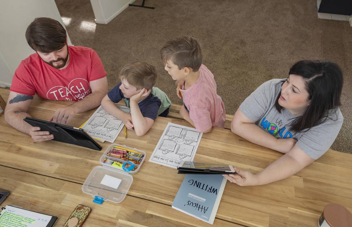 From left, Everett Mayville, 7, Christopher Houchins, a kindergarten teacher, Atticus Mayville, ...