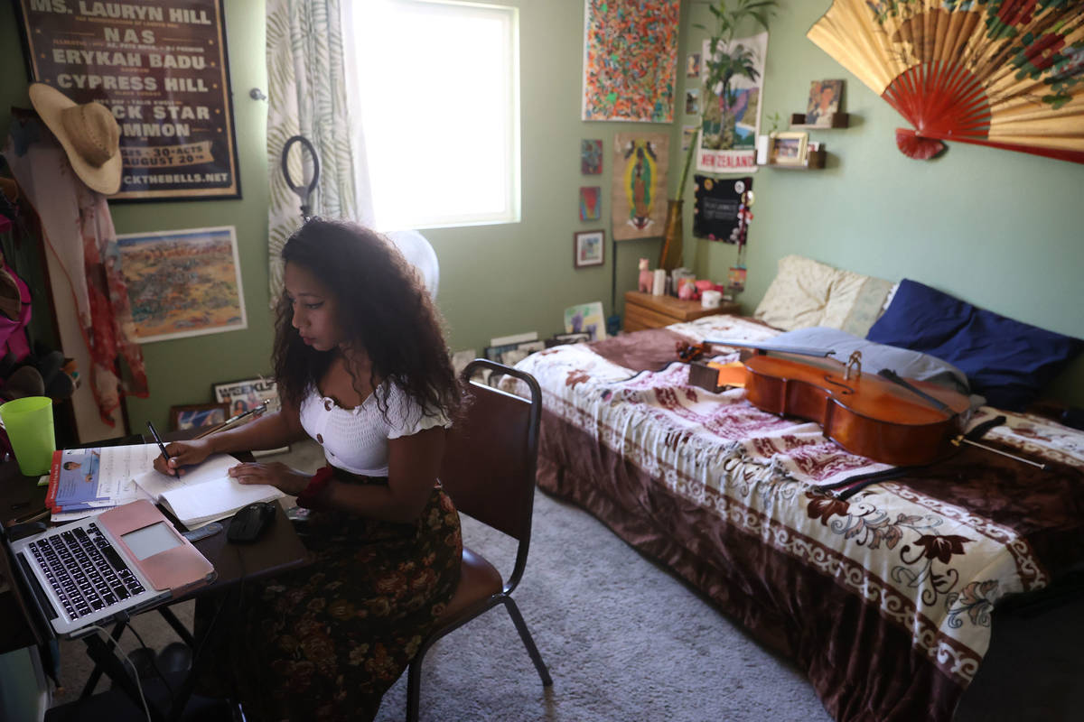 Orchestra teacher Coco Jenkins Thomas teaches students from her home in Las Vegas, Thursday, Ma ...