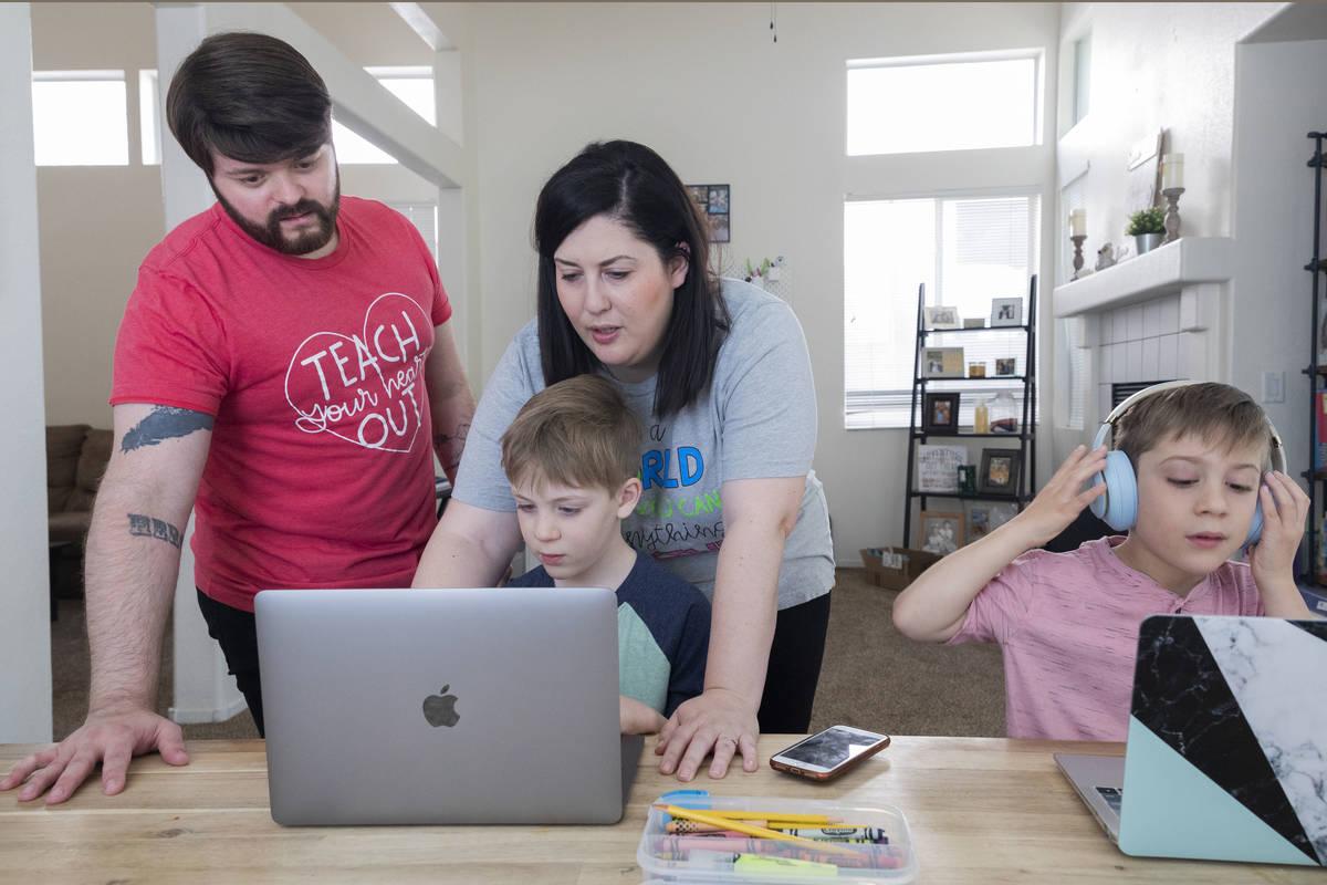 Christopher Houchins, a kindergarten teacher, left, and Jessica Houchins, a middle school coun ...