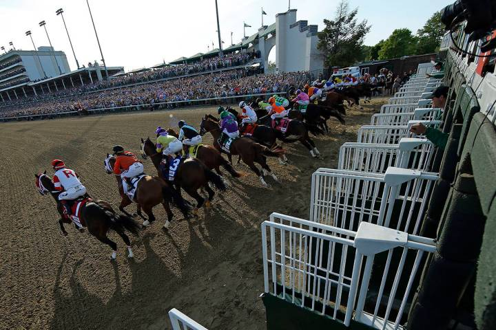 FILE - In this May 3, 2014, file photo, the field breaks from the starting gate during the 140t ...
