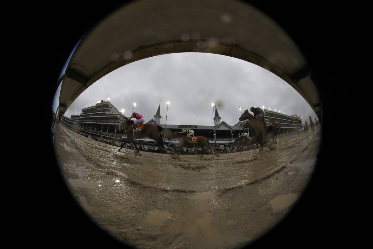 In this photo made with a fish-eye lens, Luis Saez rides Maximum Security across the finish lin ...