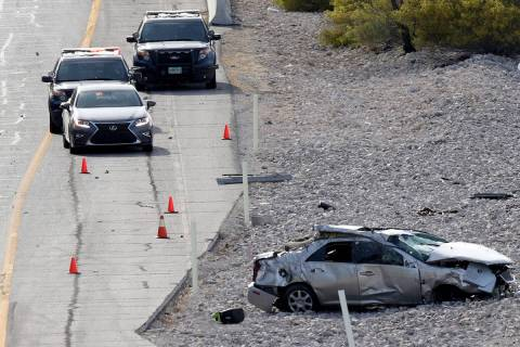 The scene of a fatal car crash on Summerlin Parkway near Anasazi Drive in Las Vegas, Thursday, ...